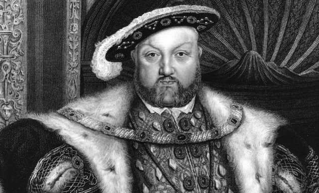 King Henry VIII sitting on a throne.