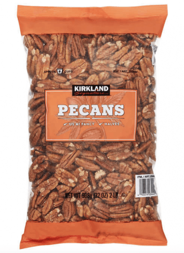 A container of Kirkland Pecans.