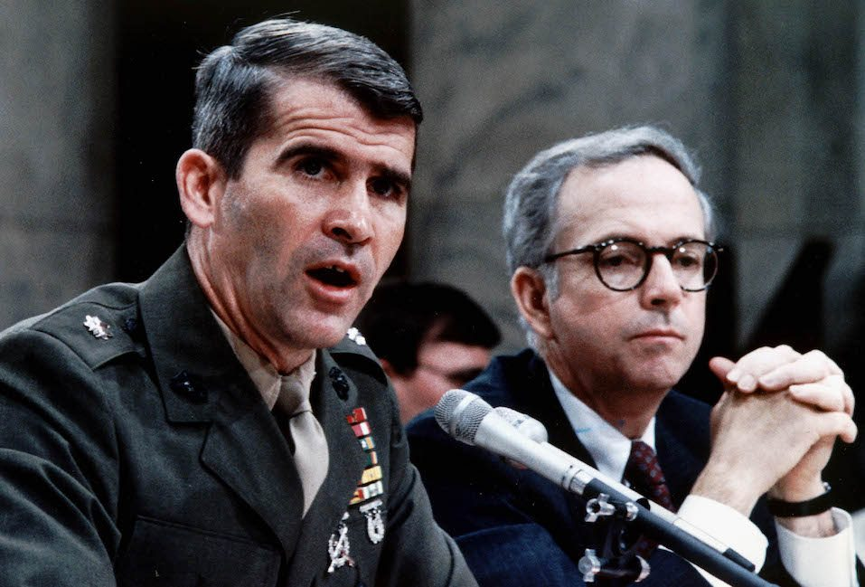 Lt. Col. Oliver North (L), accompanied by his lawyer