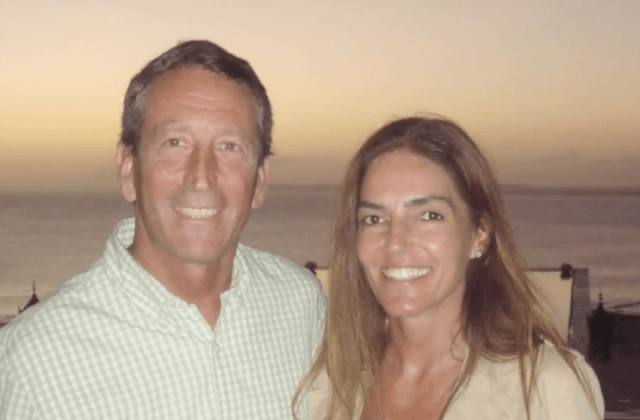 Mark Sanford and Maria Belen Chapur posing in front of a painting.