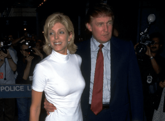 Marla Maples and Donald Trump posing in front of photographers.