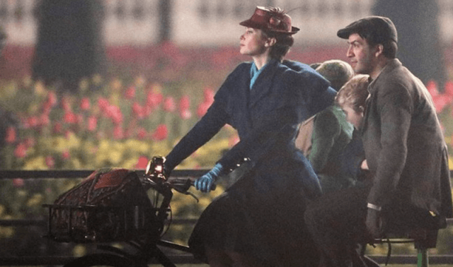 Mary Poppins rides a bike.