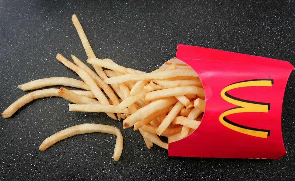French fries sit on a table at a McDonald's restaurant
