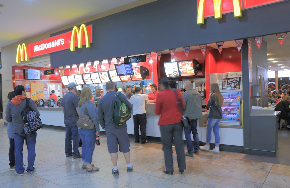 Customers line up at a McDonald's.