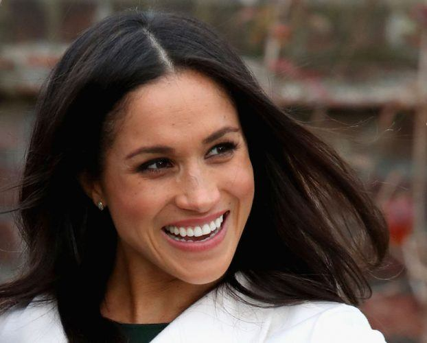 Meghan Markle smiles brightly.