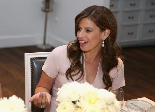 Michelle Fields converses with a guest at a formal meal.