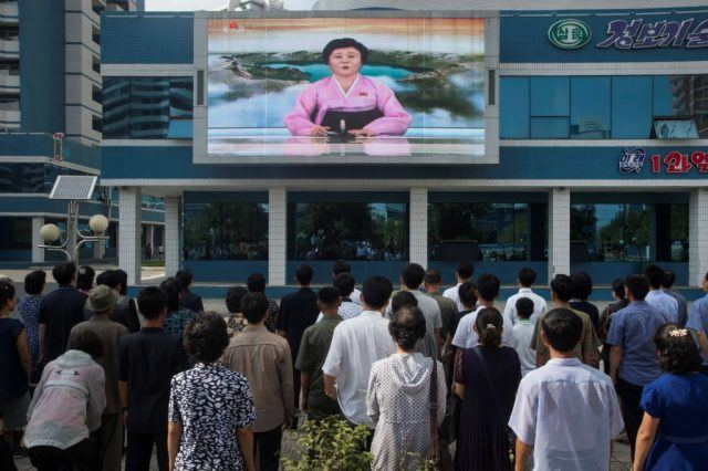 Ri Chun-Hee as she announces the news that the country has successfully tested a hydrogen bomb