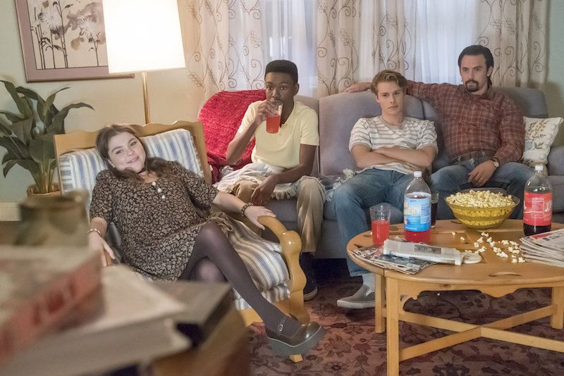 Three teens sit with their dad on a couch in This is Us