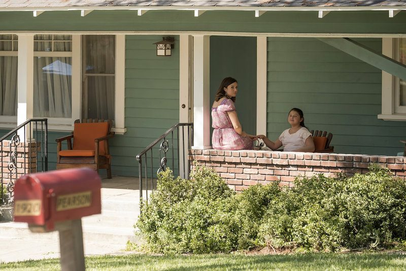 Rebecca and Kate sit on a porch on This is Us