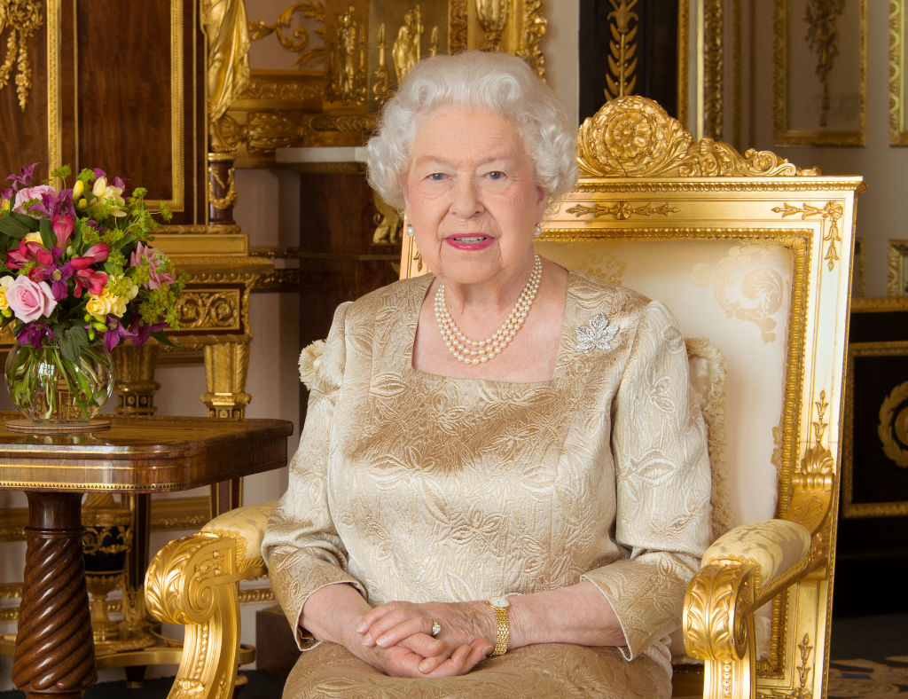 Queen Elizabeth sitting on a gold throne.