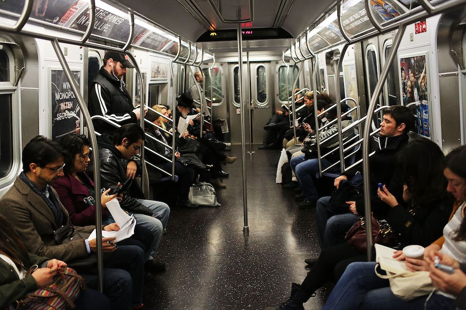 Passengers ride in a subway car two days after a man was pushed to his death in front of a train