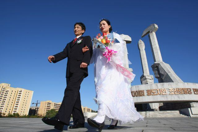 Hu Kwang Rim and his wife Hwang Ju Ok celebrate their wedding at the Monument of Party's foundation of DPR Korea on October 19, 2007 in Pyongyang, North Korea. (Photo by Alexander Hassenstein/Getty Images)