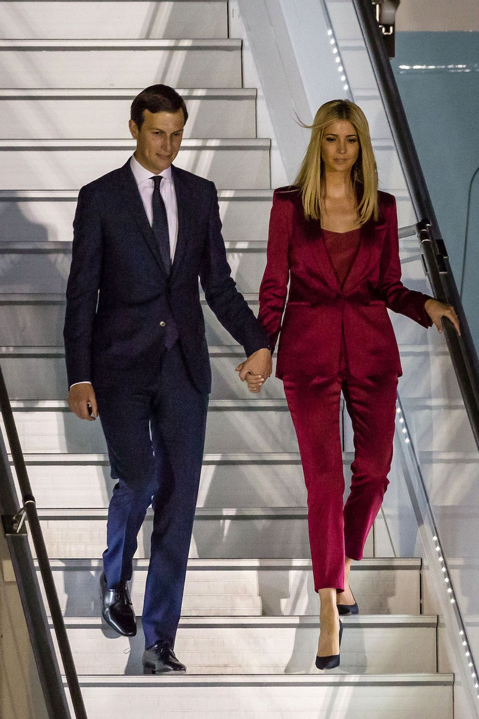 Ivanka Trump (R) and her husband Jared Kushner step off Air Force One upon arrival