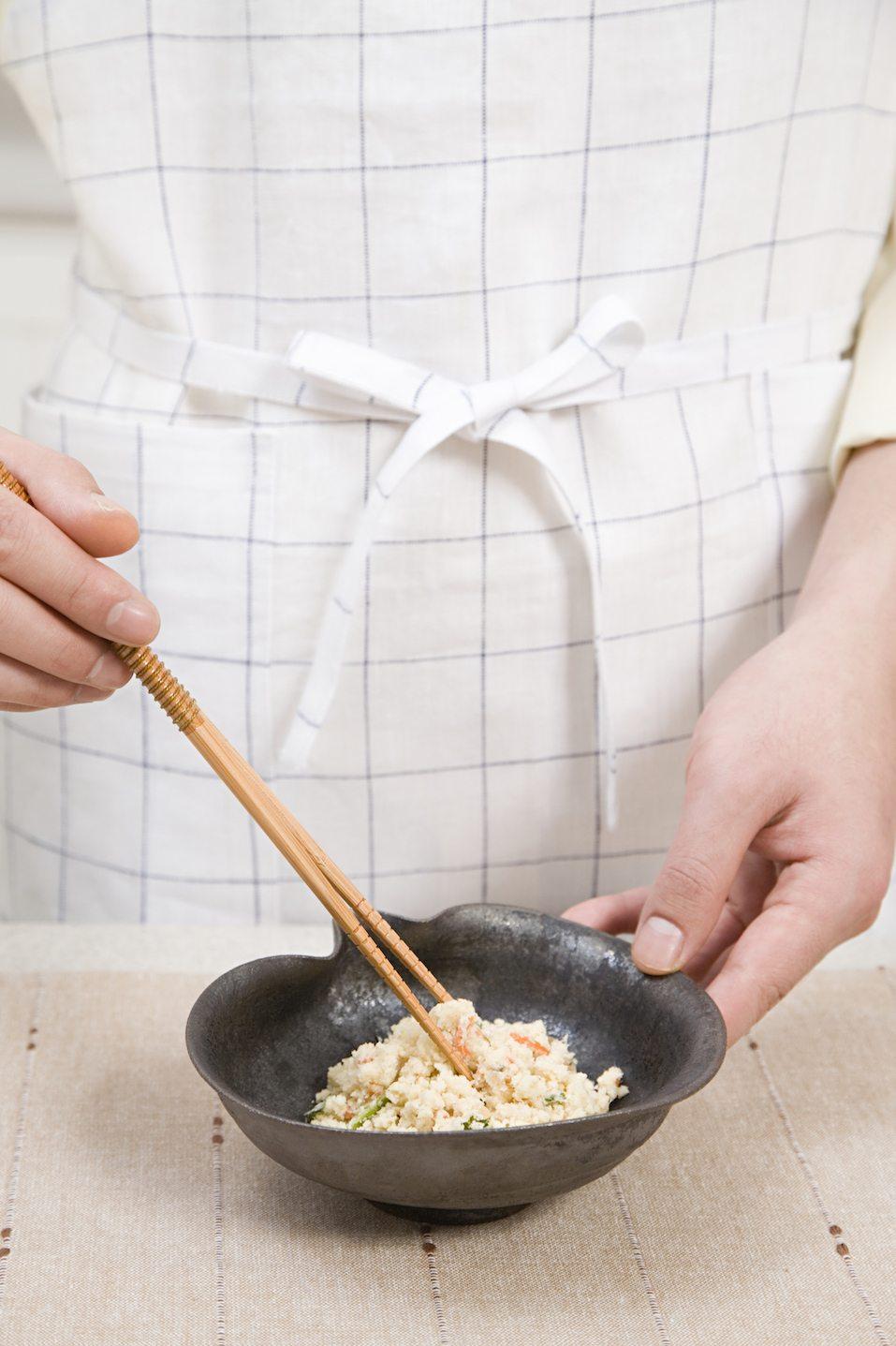 Person holding bowl of okara
