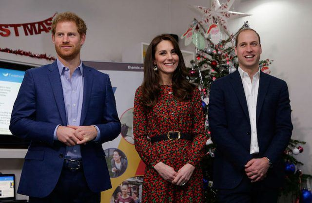 Prince Harry, Catherine, Duchess of Cambridge and Prince William, Duke of Cambridge stand ready to give an award during a visit to a Christmas party for volunteers at The Mix youth service on December 19, 2016 in London, England. The Mix youth service works with Their Royal Highnesses' Heads Together Campaign