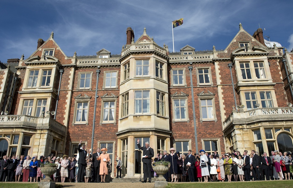 The royal family and guests stand in from of The Sandringham Estate.