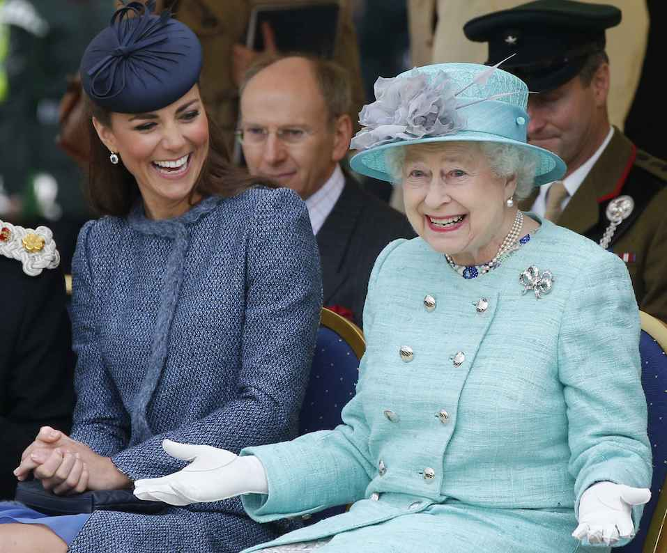 Queen Elizabeth and Kate Middleton laughing together.