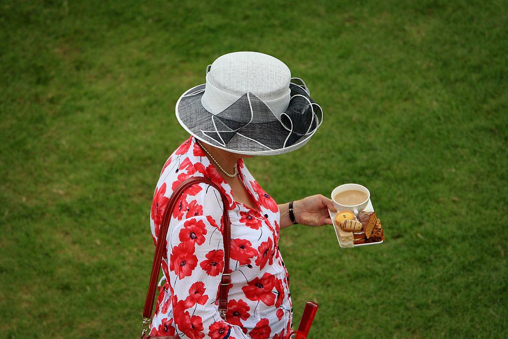 A woman holding tea
