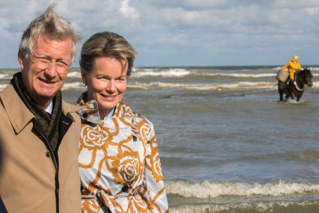 King Philippe of Belgium and Queen Mathilde of Belgium visit the horse mounted fishermen.