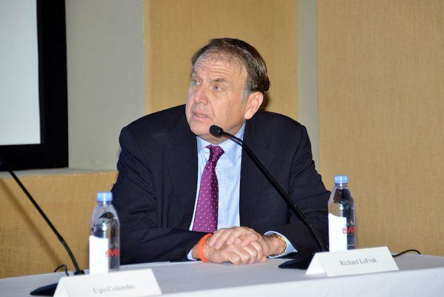 Richard LeFrak sitting at a table in front of a microphone.