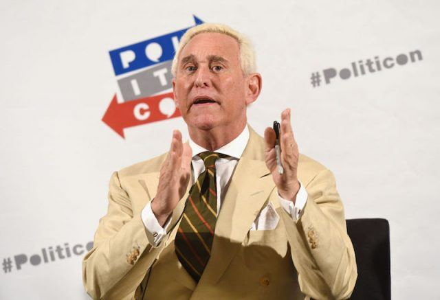 Roger Stone addressing an audience during a conference.