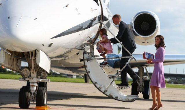 Kate Middleton boarding a plane with Prince Harry and her children.