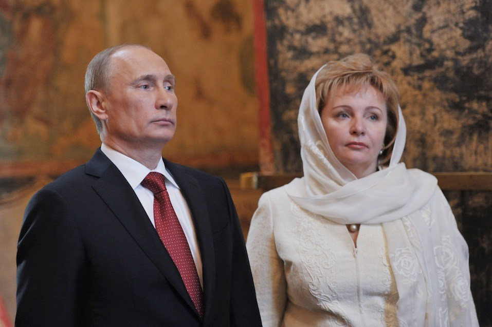 Russia's President Vladimir Putin and his wife Lyudmila attend a service at Blagoveshchensky