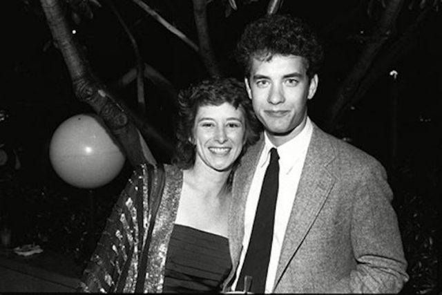 Tom Hanks posing with Samantha Lewes at a park.