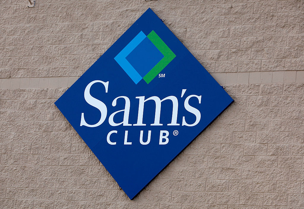 A sign hangs on the side of a Sam's Club store
