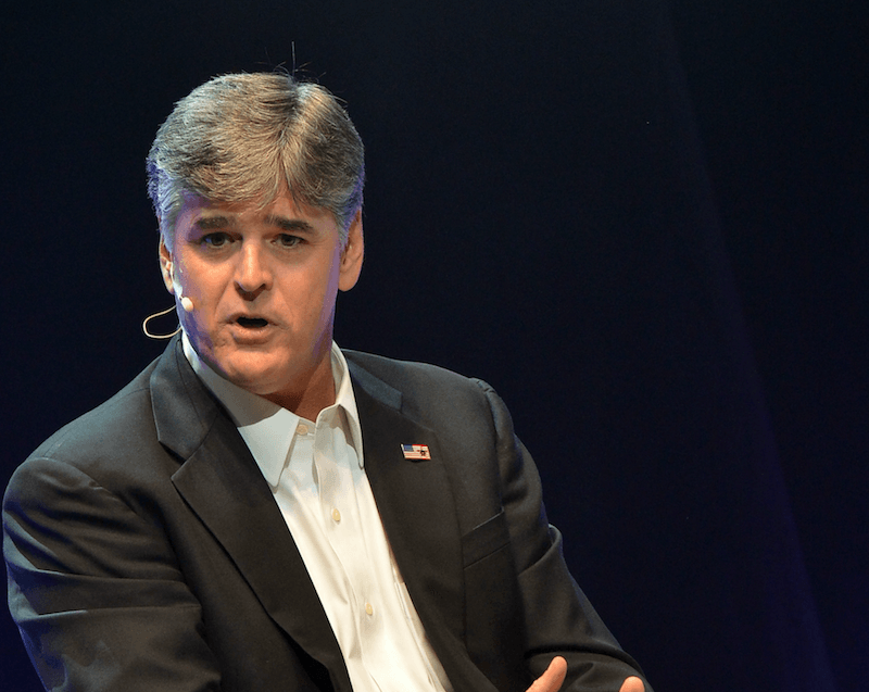 Sean Hannity speaks into a headset microphone