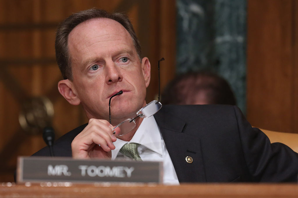 Senate Budget Committee member Sen. Pat Toomey (R-PA) listens to testimony from Congressional Budget Office Director Keith Hall