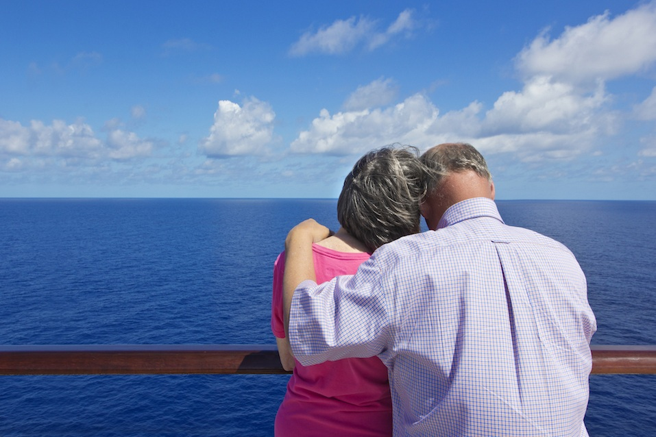 senior couple standing on cruise ship