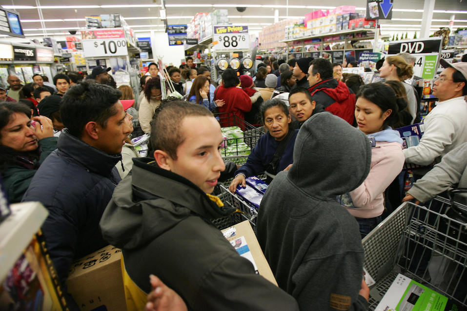Shoppers try to work their way through the crowd that mobbed the Wal-Mart