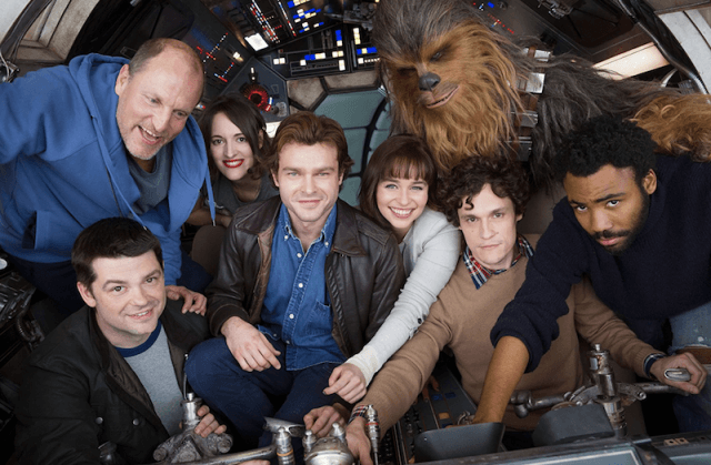 The cast of Solo: A Star Wars Storyinside a ship.