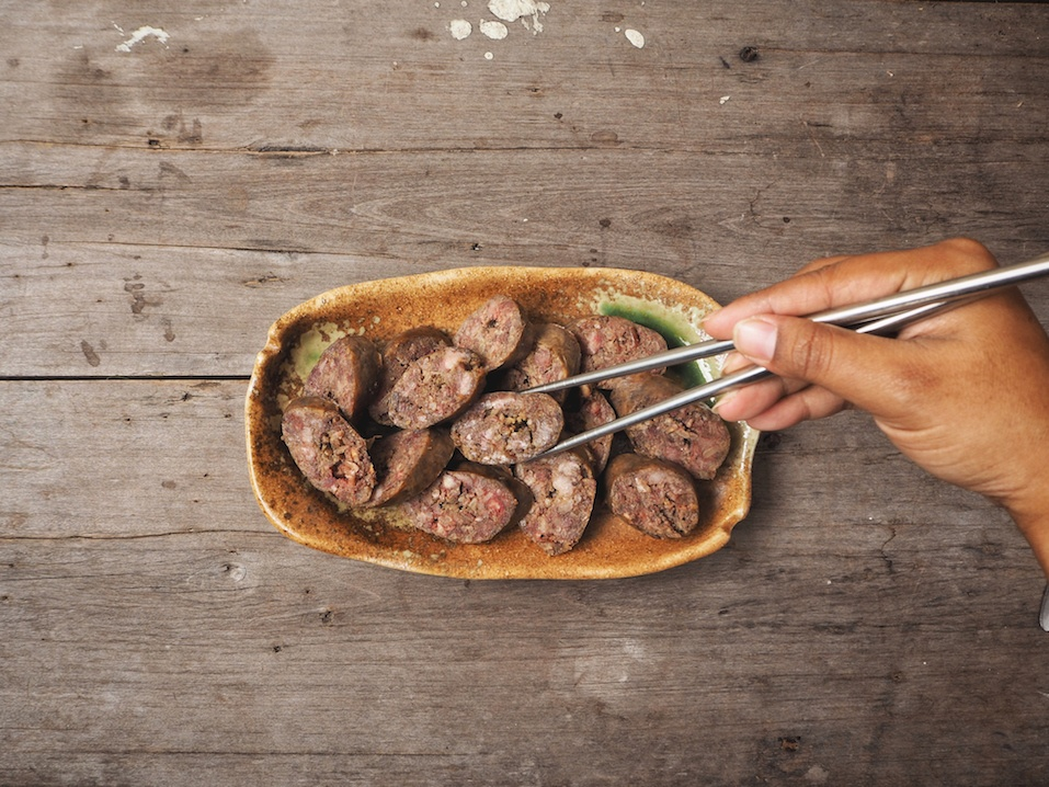 Soondae sausage with chopsticks Korean food