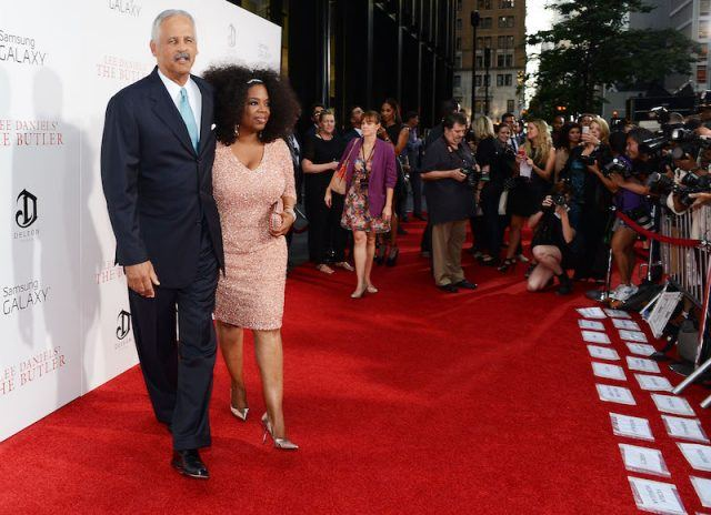 Oprah Winfrey and Stedman posing on a red carpet.