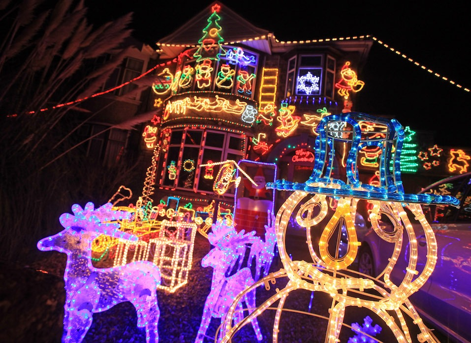 A semi-detached house is lit up with exterior Chrismas lights