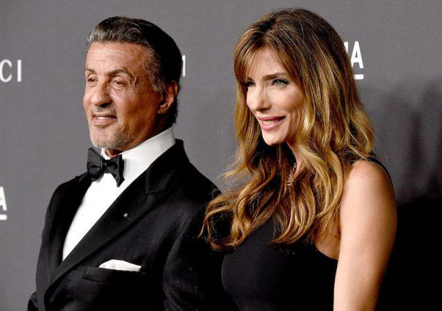 Jennifer Flavin and Sylvester Stallone pose for photos on a red carpet.
