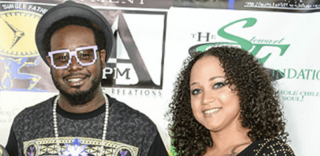 T-Pain and Amber Najm smiling on a red carpet event.