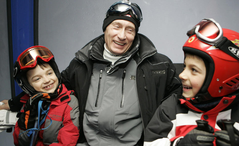 Russian President Vladimir Putin speaking with children at the Krasnaya Polyana skiing centre