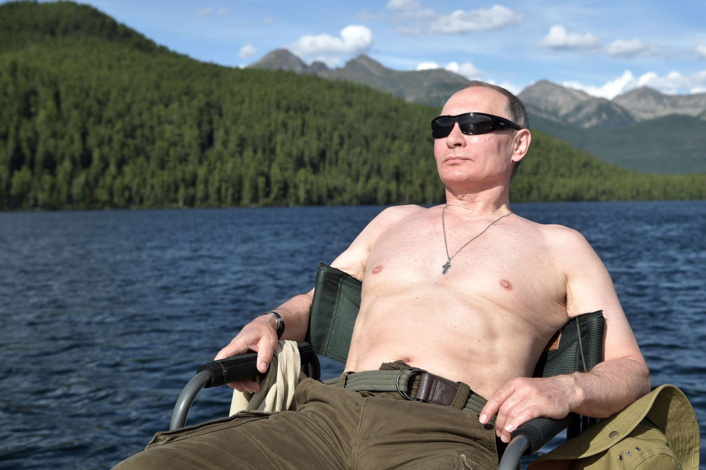 Russian President Vladimir Putin sunbathes during his vacation in the remote Tuva region