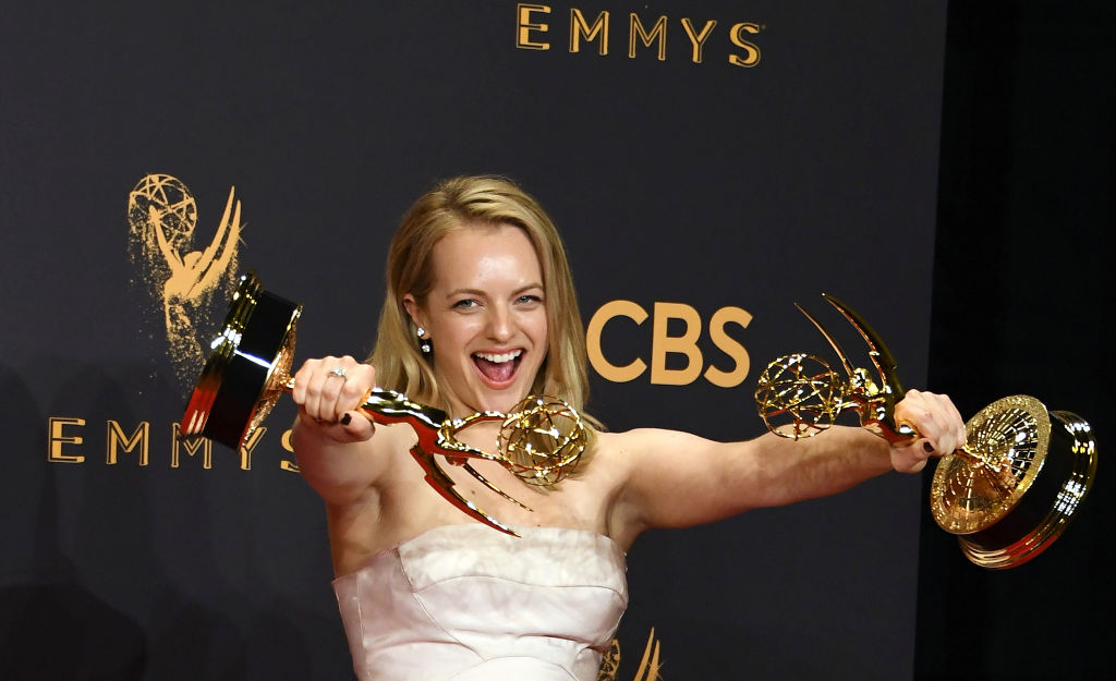Elisabeth Moss poses with the awards for Outstanding Drama Series and Outstanding Lead Actress