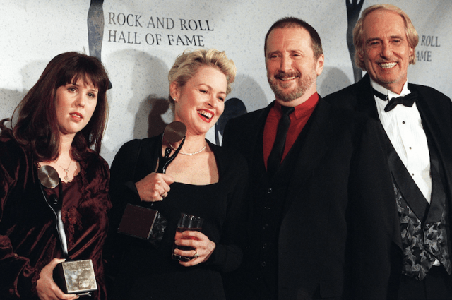 The Mamas and Papas posing together on the red carpet of the Rock and Roll Hall of Fame.