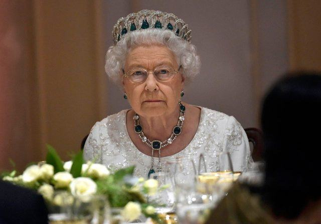Queen Elizabeth wearing a tiara at dinner