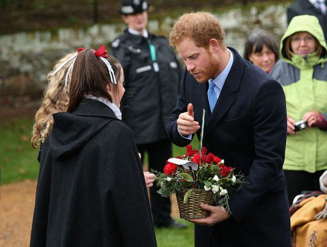 Prince Harry meets members of the public as he attends a Christmas Day church service