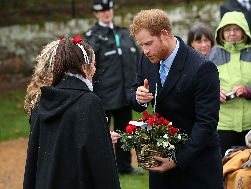 Prince Harry meets members of the public as he attends a Christmas Day church service.