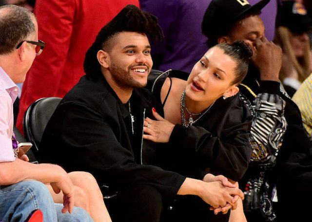 The Weekend and Bella Hadid at a basketball game.