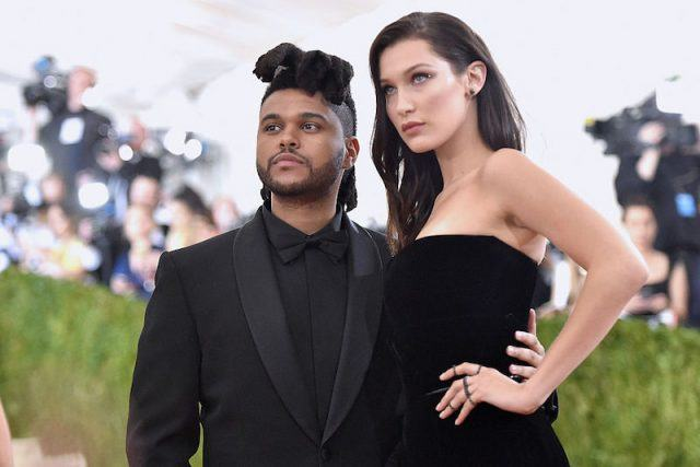 The Weekend and Bella Hadid on a red carpet.