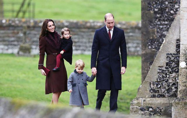 Kate Middleton holds Princess Charlotte as Prince William holds Prince George.