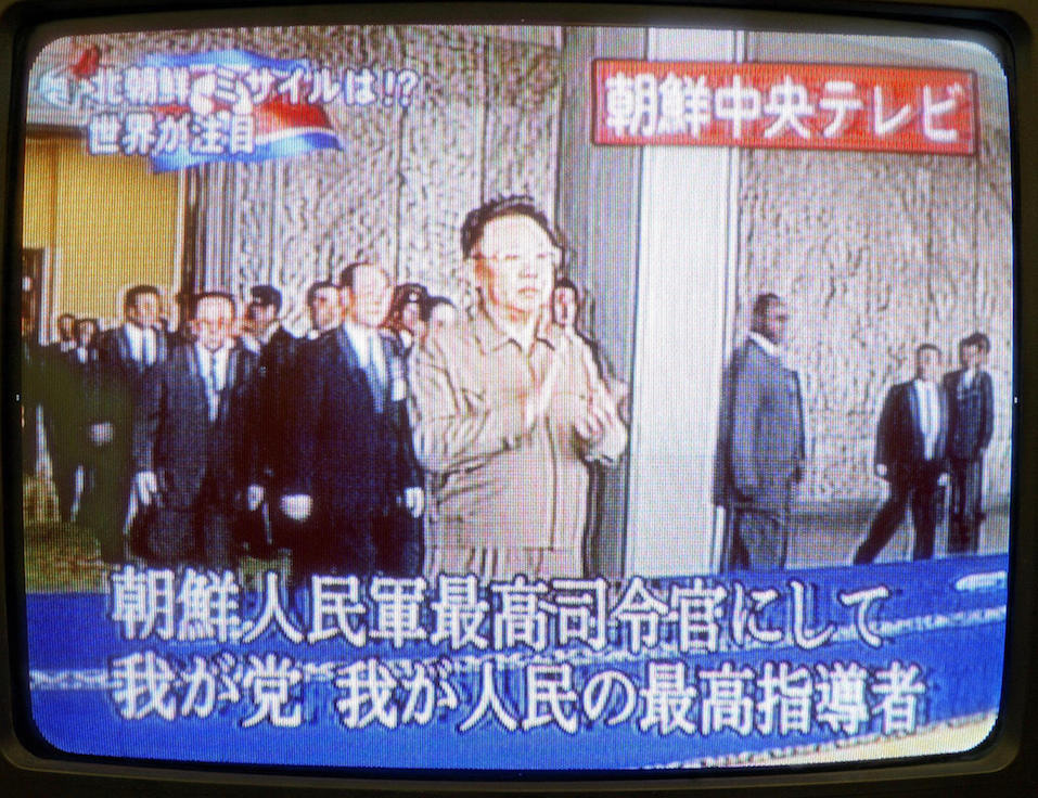 Japanese television shows North Korean leader Kim Jong-Il (C) appearing to observe a parade